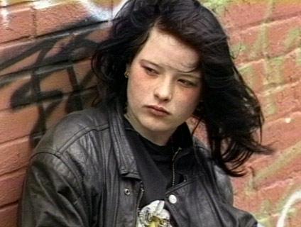 teenage girl - black hair against graffiti wall - colour 4